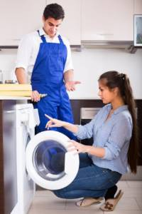 Woman discusses home appliance repair with repairman