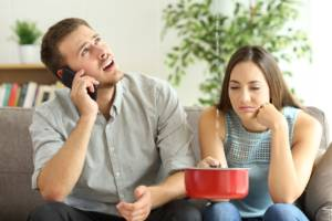 Couple calling home insurance company for leaks
