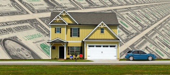 home flanked by money saved by home warranty