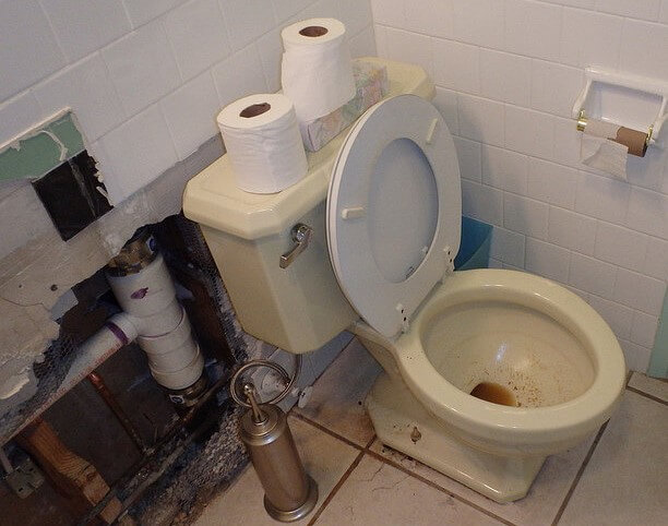 clogged toilet in bathroom