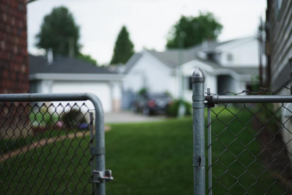 Open fence to neighbor's yard