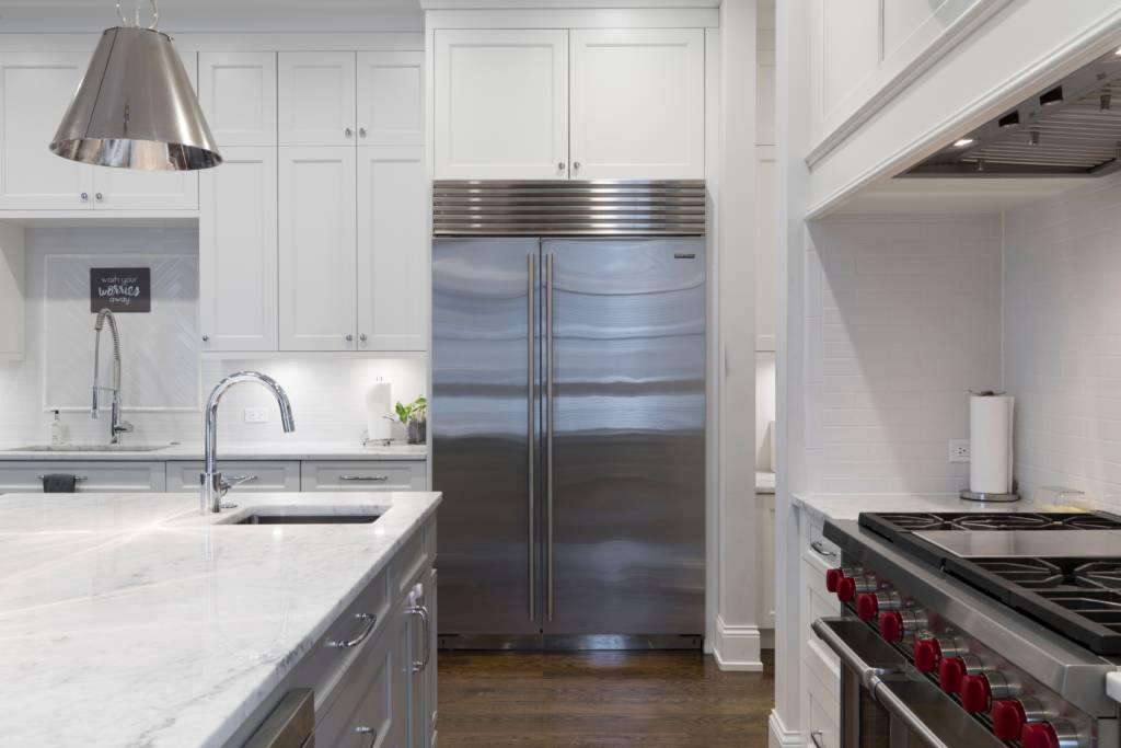 A clean stainless-steel refrigerator in a kitchen